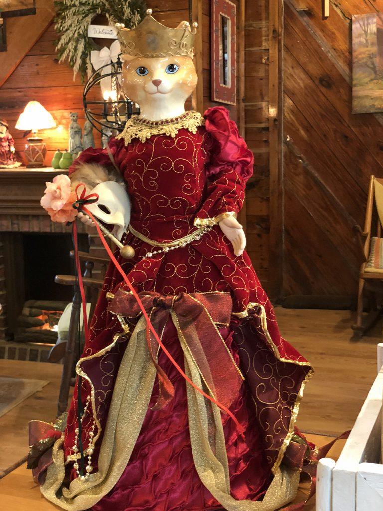 Cat Figure in Red Dress