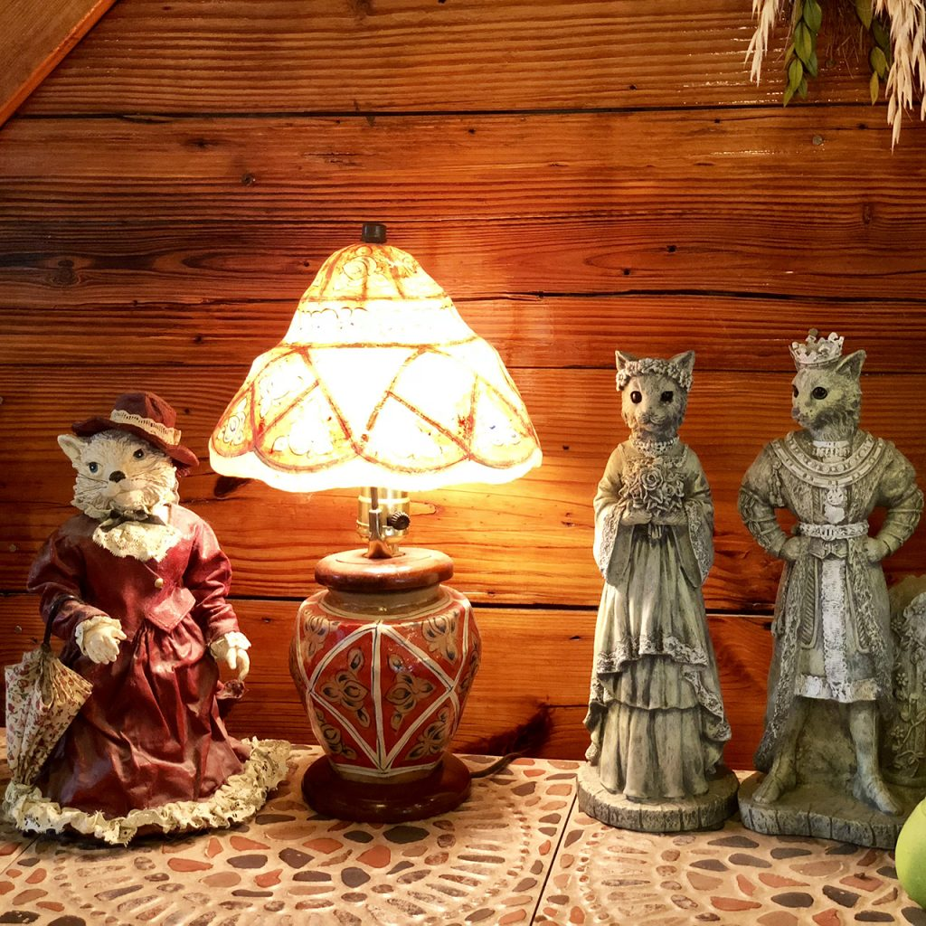 Three Cat Figurines and a Light
